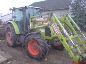Claas Axos 330C traktor z ładowaczem o mocy 90 KM