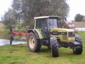 Ciagnik rolniczy Same Hurlimann 6135xb z zamontowany 4 - skibowym pługiem