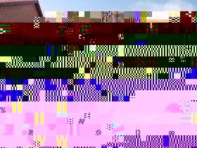 Czarny traktor Fendt 936 Vario na tle sklepu częsci widok z lewego boku