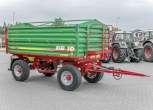 Przyczepa rolnicza Metaltech DB 10000, skrzynia ładunkowa zielona, rama w kolorze czerwonym, pomost roboczy, koło zapasowe z koszem, dyszel zaczepowy. www.korbanek.pl